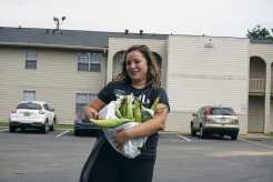 Sister Boice and her corn that someone gave us for helping them move